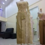 Thai nation costume in gold color.